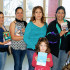 Parents and children were able to pick out a free book. Here parents pose with WAMS Librarian Nancy Spencer and WAMS principal Jamie Nino.
