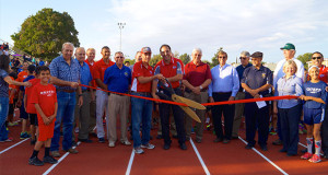 Sanger Unified School District Administrators, Sanger Chamber of Commerce Ambassadors, Sanger Unified School Board members, Sanger Unified Track Coaches and track athletes pose for the official Dodson Field Ribbon Cutting. (Photo by Cheryl Senn)