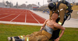 Firefighter candidate Luis Ochoa during the Victim Removal portion of the agility test. (Photo by Cheryl Senn)
