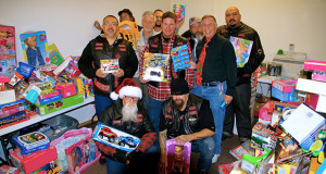 Screamin' Demons pose with Pastor Sam Estes and City Manager Brian Haddix after they delivered the more than 400 toys. (Photo by Cheryl Senn)