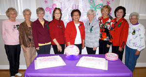 Sanger Woman's Club Board Members with the Birthday Cakes celebrating the 103 years of the Club's existence in Sanger. L to R - Doris Knowlton, Ju;i.e. Odom, Jeanne Adams, Sue Simpson, President Josie Lopez, Joanie Pruess, Delores Gonzalez, Toni Avila, and Elsie Silva. (Photo by Cheryl Senn)