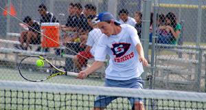 First singles player Connor Bennett, at the net. (Photo by Cheryl Senn)