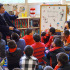 Wilson principal Ken Garcia reads to Lincoln students. (Photo by Cheryl Senn)