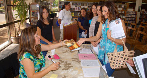 Local author, Nina Perez-Reed signs books at the Sanger Library. (Photo by Cheryl Senn)