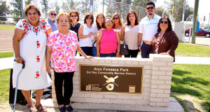 Frances Fonseca, Alex's wife, far left, with the Fonseca Family, by the new Alex Fonseca Park sign. (Photo by Cheryl Senn)