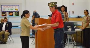 McKayla Perez-Aguilar receives an award from Dewain Bolin from AMVETS Post 98. (Photo by Lily Vang)
