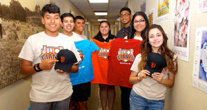 Sanger Parks & Recreation Interns and Junior Giants Staff. L to R - Zaccariah Lopez, Anthony Pimentel, Isaiah Lopez, Junior Giants Commissioner Celeny Sustaita, Charles Flewellen, Estrella Conde and Dorian Salas. (Photo by Cheryl Senn)