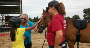 Unity Estates child day camper, Brianna Rios, working with Mary, from Abundant Life Ranch,  working on getting comfortable withe a horse before she rode it. (Photo courtesy Ali Valencia)