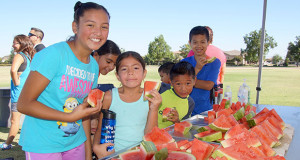 Watermelon Run participants were able to enjoy fresh watermelon after running in the morning races. (Photo by Cheryl Senn)