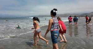 Children have fun running on the beach. (Photo courtesy Ali Valencia)