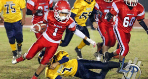 """Fernando """"BooBoo"""" Gonzalez making a swift move that opened up the play that led to an approximate 65 yard touchdown. (Isaiah Salazar from Landmark Photography"""