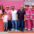 Pink Heals firefighters pose with the family of WAMS student Miguel Garcia. (Photo by Cheryl Senn)