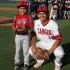 Apache Varsity Jordon Paz poses with Cal Ripken Yankee Jay Ruiz after Ruiz threw out pitch. (Photo by Cheryl Senn)