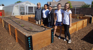 Quail Lake 3rd grade students pose by the new raised beds and in front of the refreshed green house in the Quail Lake Garden. Pictured are Tanner Russo, Sophia Santos, Gianna Manfredi, Hayden Craft and Luce Lucas. (Photo by Cheryl Senn)