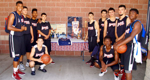 Sanger High Apache Boys Basketball team by the picture and jersey of Evan Medina who the tournament was held in memory of. (Photo by Cheryl Senn)