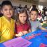 Benjamin Amaya, Jakeline Recinos, and Juan Amaya at the Building Words station. (Photo by Cheryl Senn)