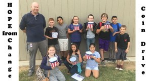 Centerville Student Council members collected coins on the Centerville campus. Students are pictured with Michael Hamilton,  the Student Council advisor. (Photo by Cheryl Senn)
