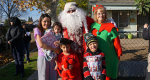 Santa and his Elf visit with families who came out to see Santa on his designated family list. (Photo by Cheryl Senn)