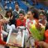 Sanger High Senior Destiny Paez is given gifts by team mates on Senior Night. (Photo by Cheryl Senn)
