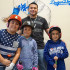 Slugger's Club co-owner, Josh Garza, with some  Little League and Cal Ripken players, before they entered the batting cages. L to R - Chris Calderon, Jaylynn Ruiz, Garza and Jay Ruiz. (Photo by Cheryl Senn)