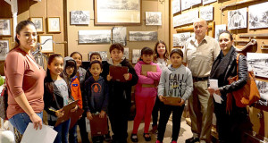 Sanger Historical Society trustee and Sanger Unified School District School Board member Ken Marcantonio provides Reagan Elementary School students with information on a Sanger Depot Museum. (Photo by Cheryl Senn)
