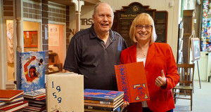 Gerald Adams, Docent and Historical Society Board Member, and Susan Good who found her yearbook at the Sanger Depot Museum. (Photo by Cheryl Senn)