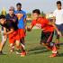 Apache Varsity players Ricky Moreno runs against Josiah Lopez while Coach Mario Gonzalez observes. (Photo by Cheryl Senn)