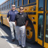 Brad Pawlowski, Director of Facilities and Construction, and Jimmy Robles Director of Support Services/Transportation Department stand by Sanger Unified's newest bus, bus number 44, a 2016 International. (Photo by Cheryl Senn)
