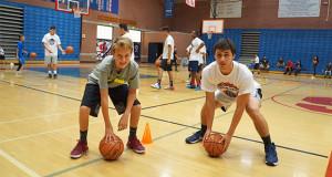 SHS Varsity Basketball player, Isaiah Rodriguez, coaching Tad Tibbett during the z-slide station. (Photo by Cheryl Senn)